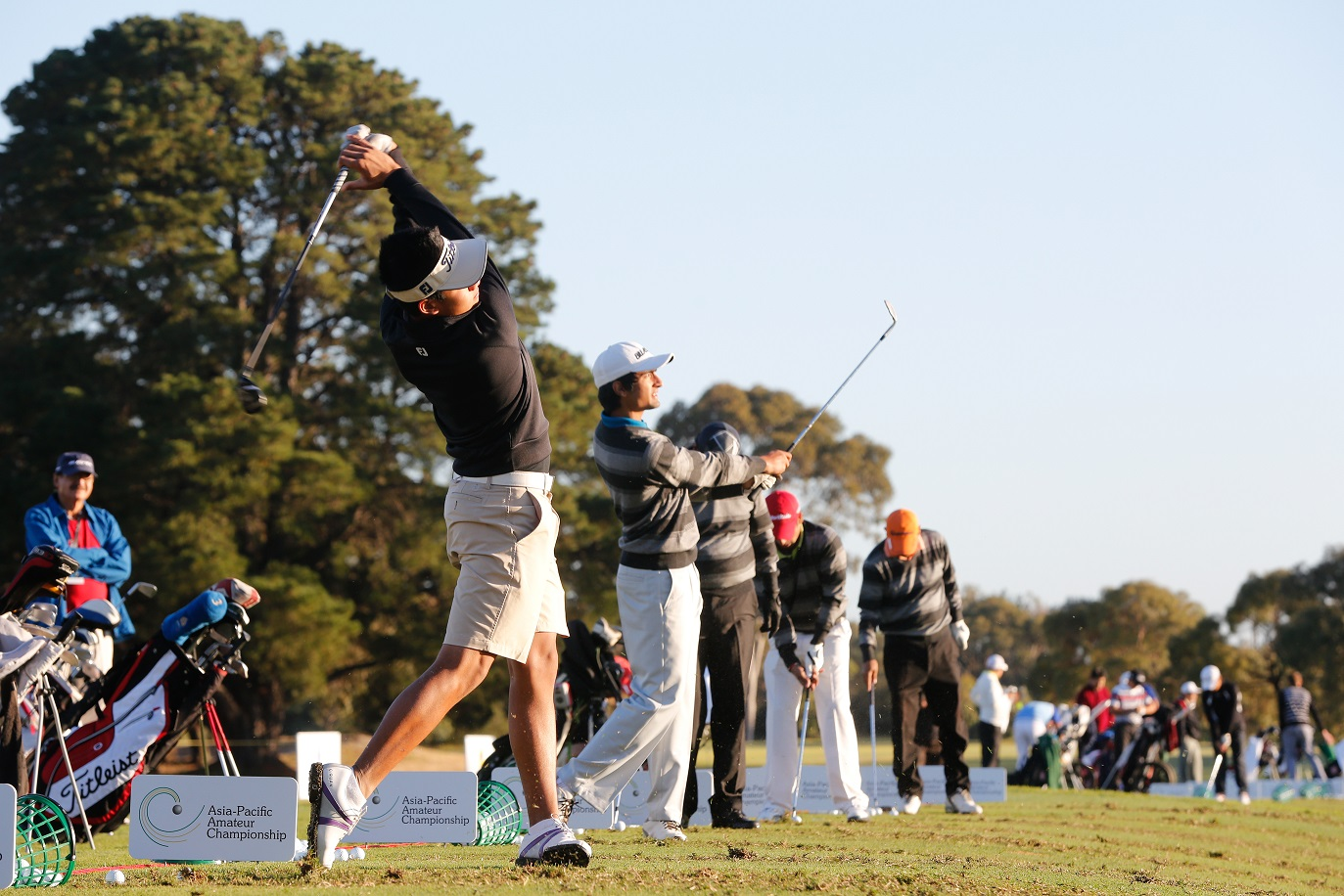 Melbourne, Australia: Golfers warm up on the range prior to their practice round at the Asia Pacific Amateur Championship at the Royal Melbourne Golf Club ) on October 21 2014, (photo by Dave Tease/AAC)