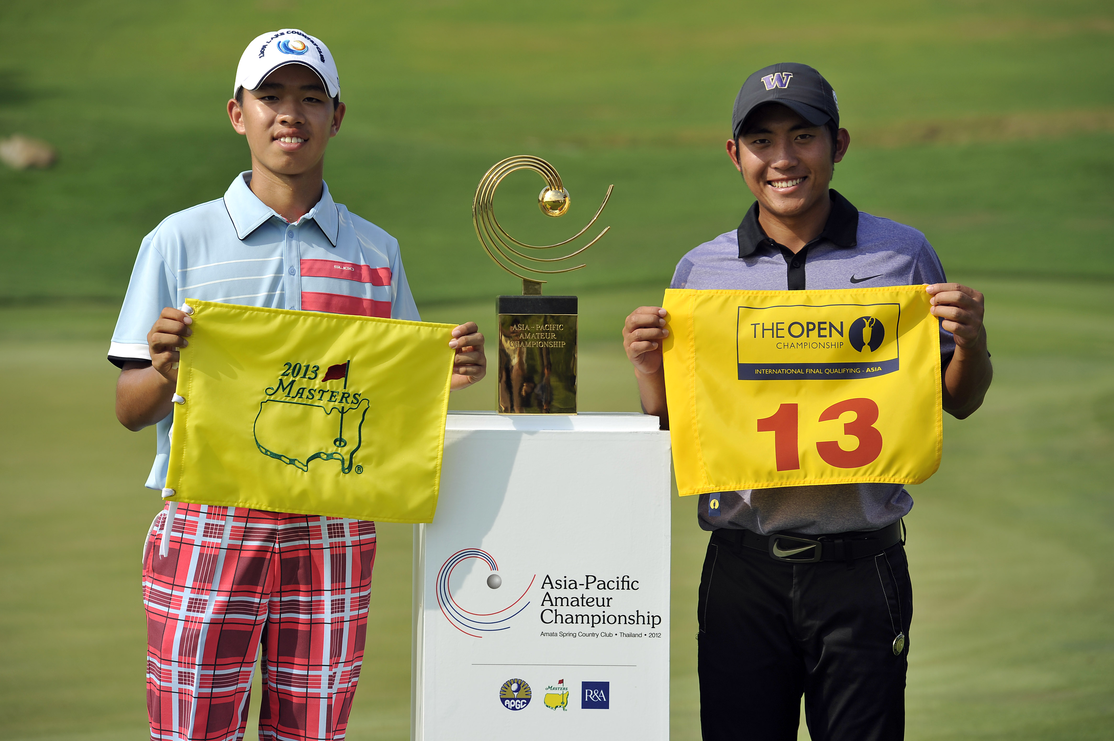 CHON BURI-THAILAND - Guan Tianlang of China, tournament winner, left and Cheng Tsung Pan of Chinese Taipei, runner-up pictured on November 4, 2012, during the final day of the 2012 Asia-Pacific Amateur Championship at Amata Spring Country Club, Chon Buri, Thailand. Photo by Paul Lakatos/AAC.