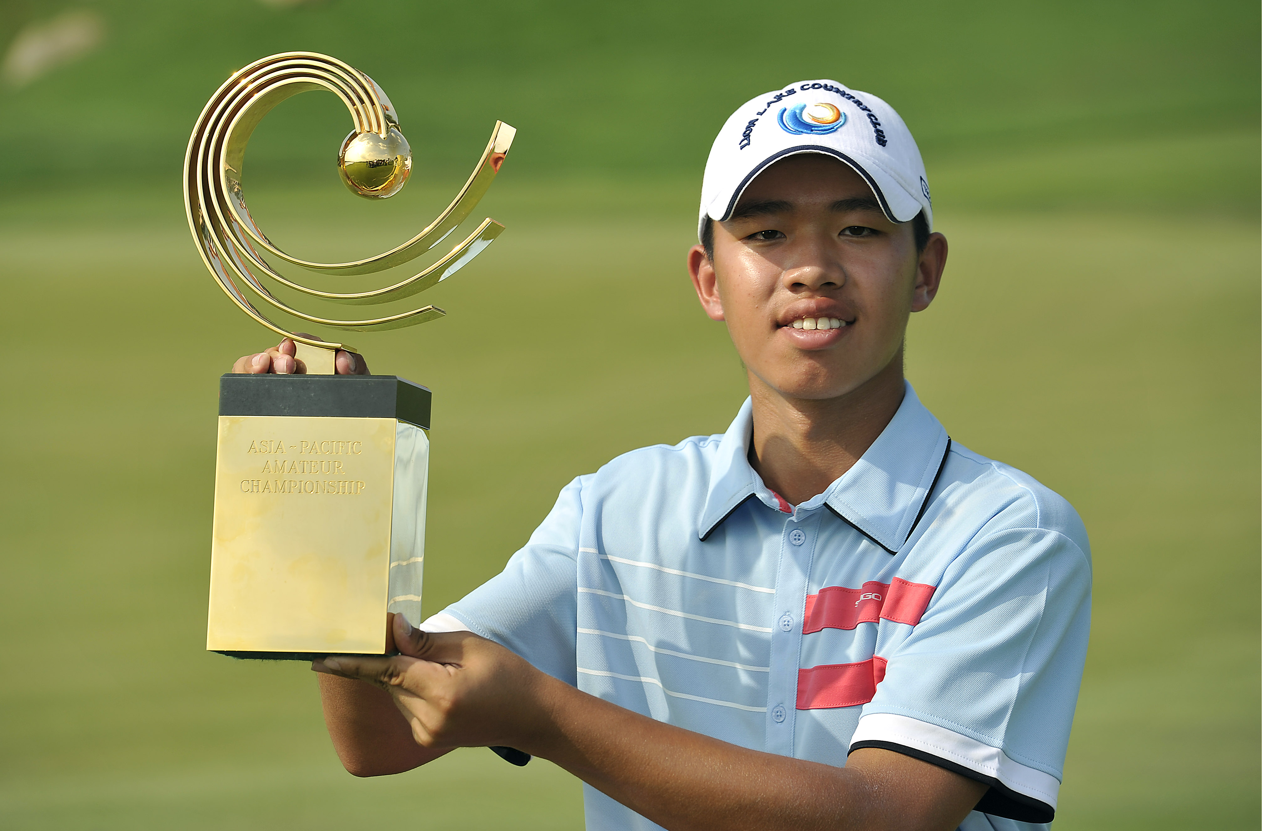 CHON BURI-THAILAND - Guan Tianlang of China pictured on November 4, 2012, during the final day with the winner's trophy at the 2012 Asia-Pacific Amateur Championship at Amata Spring Country Club, Chon Buri, Thailand. Photo by Paul Lakatos/AAC.