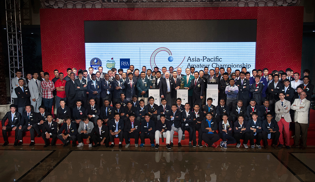 LONGKOU CITY, China - The welcome reception group photo during the Asia-Pacific Amateur Championship at the Nanshan International Golf Club, Garden Course - October 24-27, 2013. Picture by David Paul Morris/AAC.